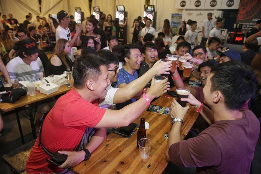 Guests making a toast at the electronic marquee at the Beerfest Asia event last Saturday.