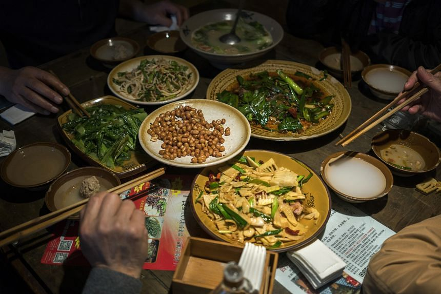 A table full of traditional Sichuan dishes at Tian Yuan Yinxiang in Chengdu. Old-timers want to preserve the cuisine's culinary heritage.