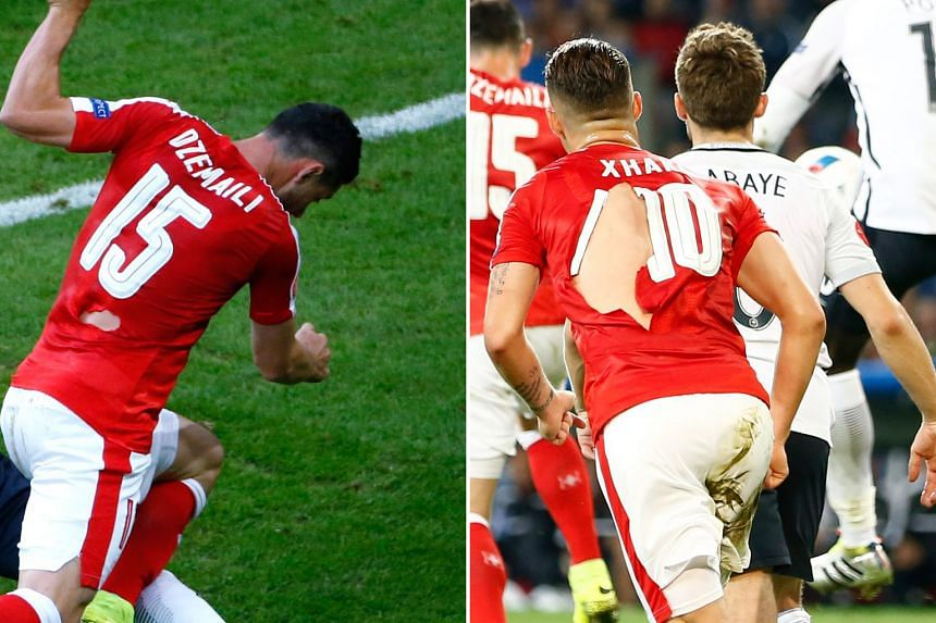 Blerim Dzemaili(far left) and Granit Xhaka's shirts were among those torn during the game against France. The Swiss will be hoping for their kit manager to be better prepared when they play in the last 16.