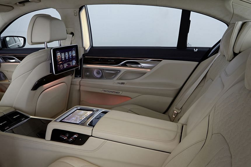 The BMW 750Li comes with remote-controlled parking (far left), a removable Samsung tablet to control the infotainment (left) and a wine chiller (above).