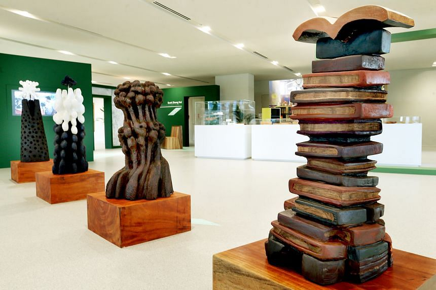 """Artist Fabrizio Galli (above) with his work, Tete-a-tete, a bench with tall backrests; and """"pencil"""" benches (left) by exhibition curators Faith Teh and Caroline Pang. Heap Of Books (above right), a tower of books topped off with an open tome, is one"""
