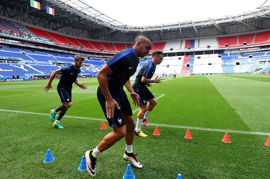 France forwards Dimitri Payet (front) and Antoine Griezmann training in Lyon's Parc Olympique Stadium ahead of their clash against Ireland. The duo are likely to provide support up front for Olivier Giroud.