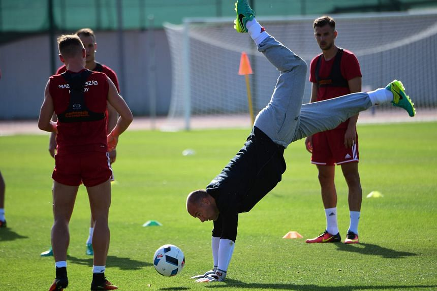 Hungary goalkeeper Gabor Kiraly limbers up before their training session. The 40-year-old has conceded four goals so far in Euro 2016.
