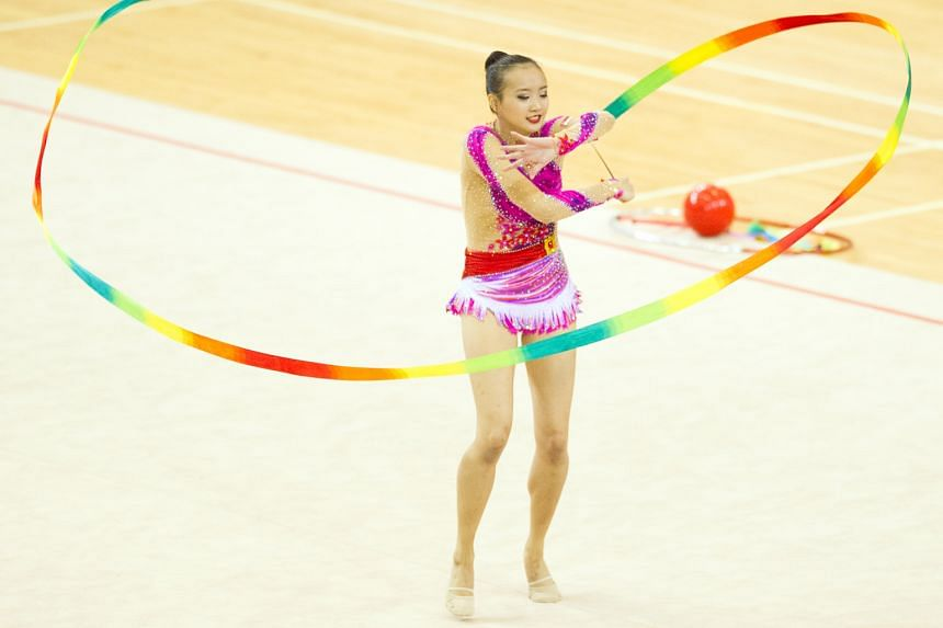 National gymnast Tong Kah Mun, 18, twirling her colourful ribbon while performing her routine at the Singapore Open Gymnastics Championships at Bishan Sports Hall. After finishing second in the ribbon competition yesterday, the all-around runner-up a