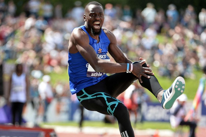 Former triple jump world champion Teddy Tamgho clutching his knee in agony after breaking his leg at the French athletics championships on Saturday. The Frenchman is expected to be out for at least six months.
