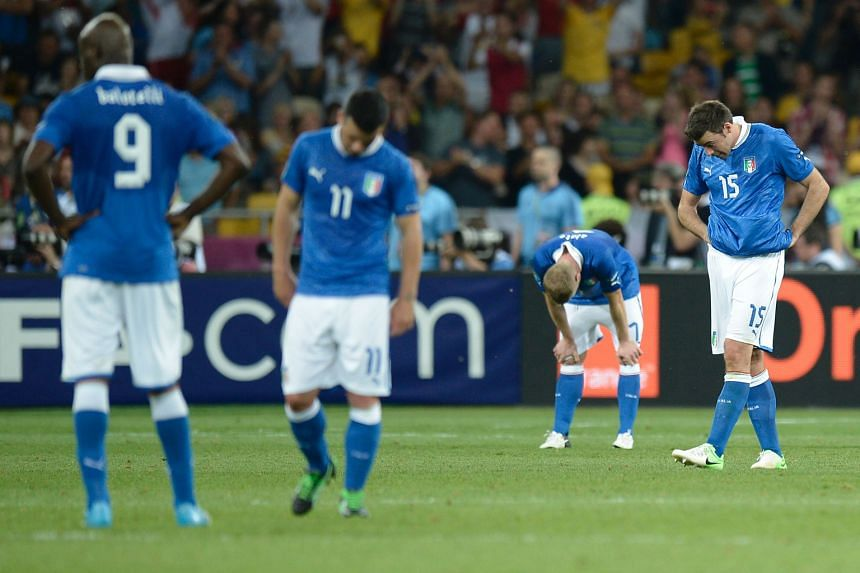 The Italy players' body language says everything about the agony of defeat in this image, taken moments after Spain scored their final goal in the 4-0 rout of the Azzurri in the Euro 2012 final in Kiev.