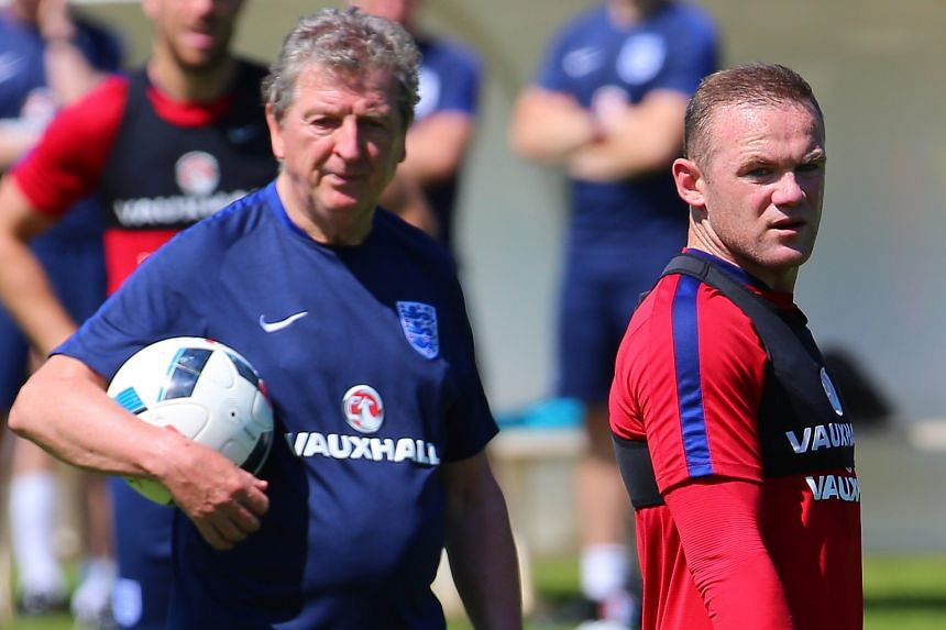 "Roy Hodgson and Wayne Rooney at a training session last week. While the manager has ""no regrets"" about dropping Rooney against Slovakia, a loss to Iceland would end his time at the helm."