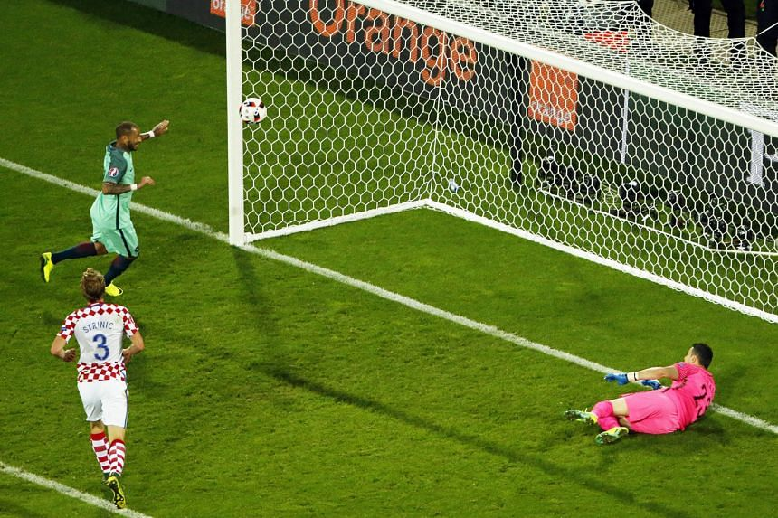 Above: Portugal's Ricardo Quaresma (in green) nodding in the extra-time winner, after Croatia's Danijel Subasic could only parry Cristiano Ronaldo's shot into his path. The substitute's goal was enough to give Portugal their first victory in France s