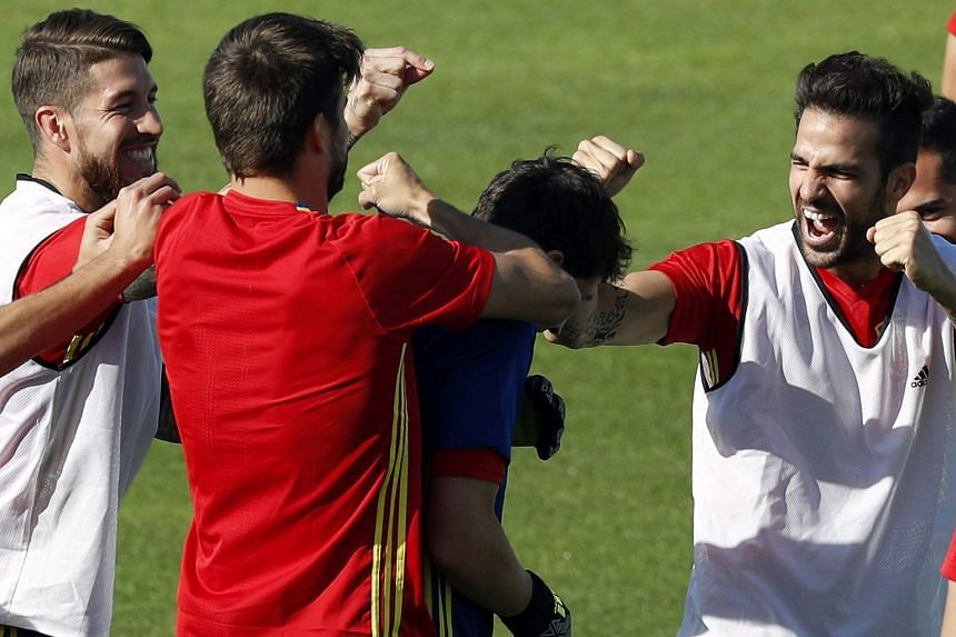 Spain's (from left) Sergio Ramos, Gerard Pique, Iker Casillas and Cesc Fabregas sharing a lighter moment in training ahead of their last-16 tie with familiar foes Italy. The Spanish hold the upper hand in the form book, having met and defeated the It