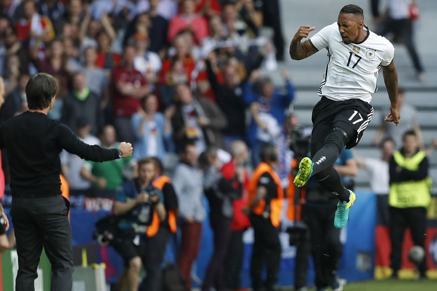 Left: Julian Draxler (left) volleying home to open his account at Euro 2016 and seal Germany's 3-0 win over Slovakia. The midfielder also capped his performance with an assist for Mario Gomez and was named as Uefa's Man of the Match. Below: Defender