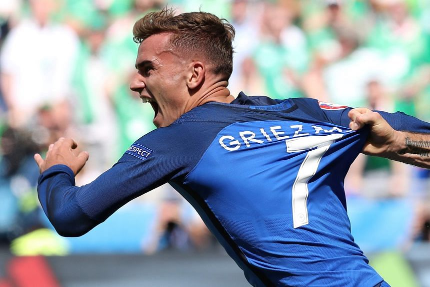 France's Antoine Griezmann celebrating after scoring a goal against Ireland. He scored both goals in the 2-1 last-16 victory.
