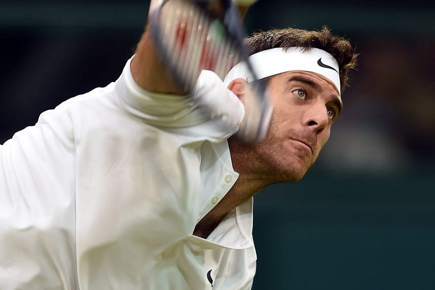 Juan Martin del Potro of Argentina serving against Stan Wawrinka of Switzerland at Wimbledon yesterday. Del Potro, the 2009 US Open champion, came back from the loss of the opening set to win 3-6, 6-3, 7-6 (7-2), 6-3 in the second round.