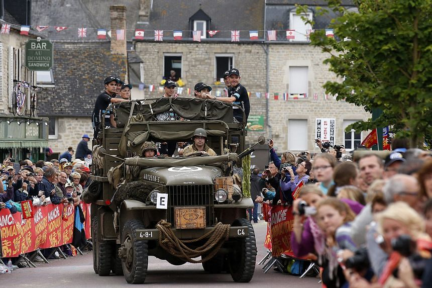 Team Sky rider Chris Froome (centre) and his team-mates arriving in a vintage military truck for the team's presentation ahead of the 103rd Tour de France, which starts in Mont Saint-Michel today.