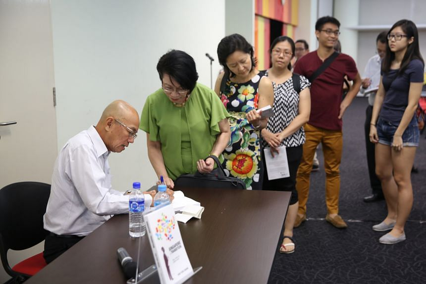 Former Straits Times editor Han Fook Kwang signing his book for readers at The Big Read Meet.