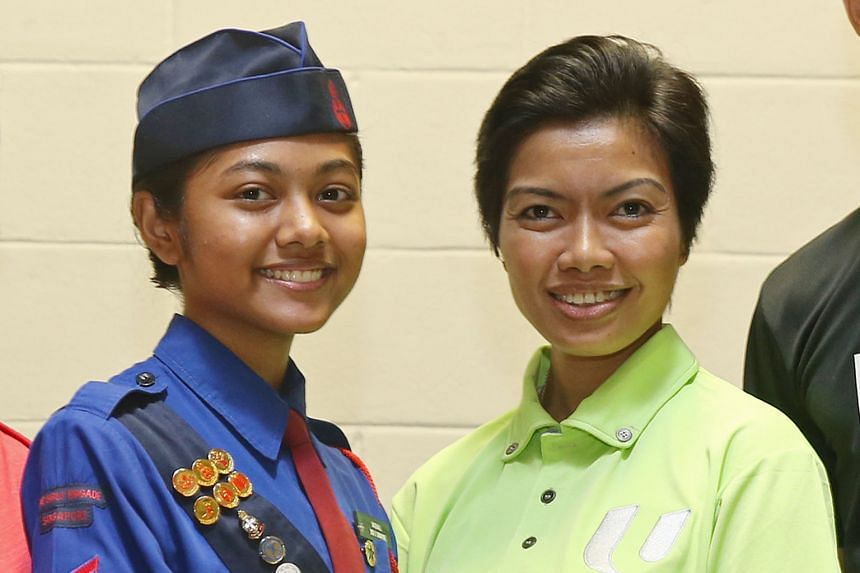 Far left: Vaishali is a first-time participant in the Girls' Brigade contingent. Left: Ms Siti has been taking part in the NDP for more than 10 years.