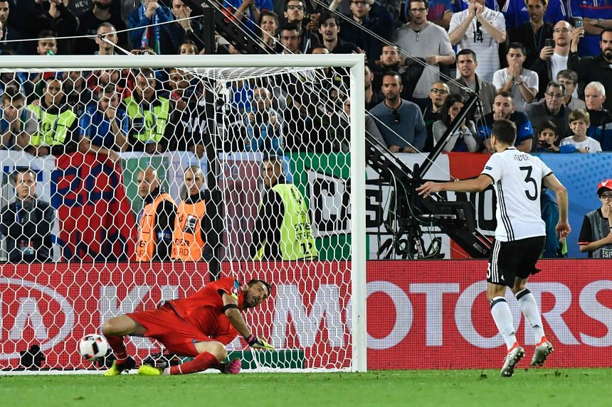 Germany defender Jonas Hector's spot kick squirms beneath diving Italy goalkeeper Gianluigi Buffon, giving Germany a 6-5 shootout win to advance to the semi-finals.