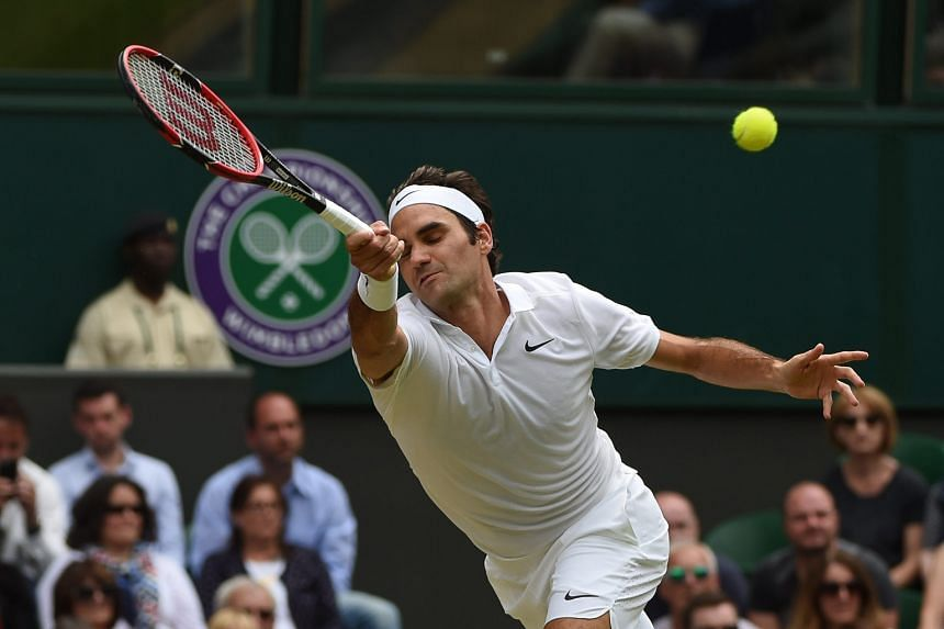 Switzerland's Roger Federer in action against Steve Johnson of the US in their fourth-round match at Wimbledon. The Swiss won 6-2, 6-3, 7-5.