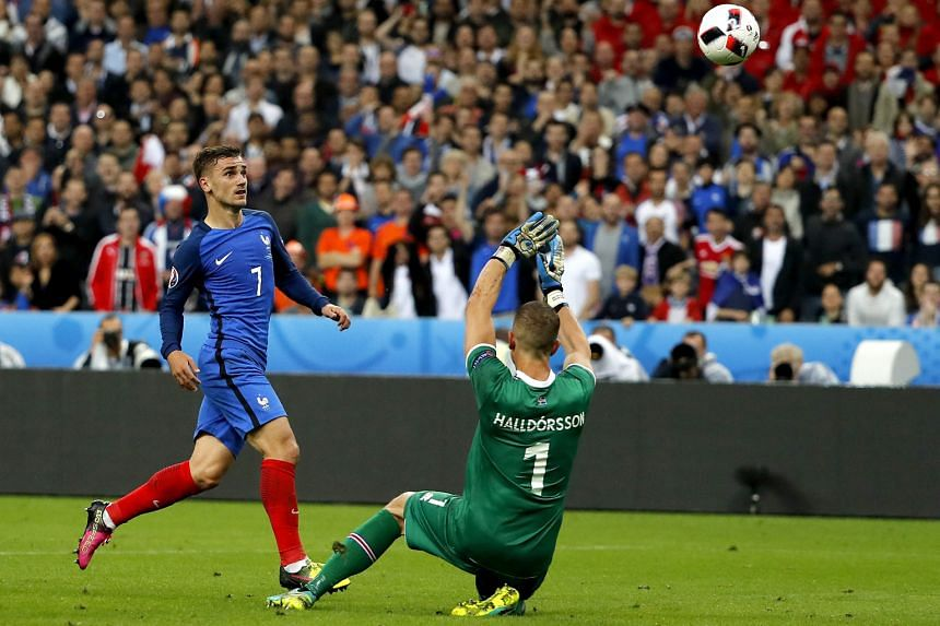Antoine Griezmann chipping the ball over goalie Hannes Halldorsson for France's fourth goal, after Iceland's high defence line was picked apart yet again.