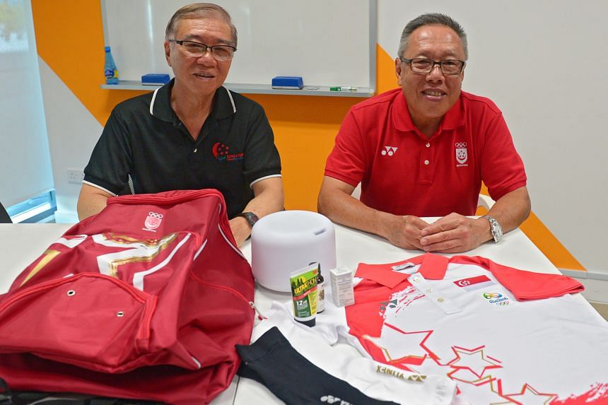 Ho Cheng Kwee (left), Singapore's Paralympics chef de mission and Low Teo Ping, who will lead the Olympic team, with special items such as arm and calf sleeves, insect repellent and permethrin solution.