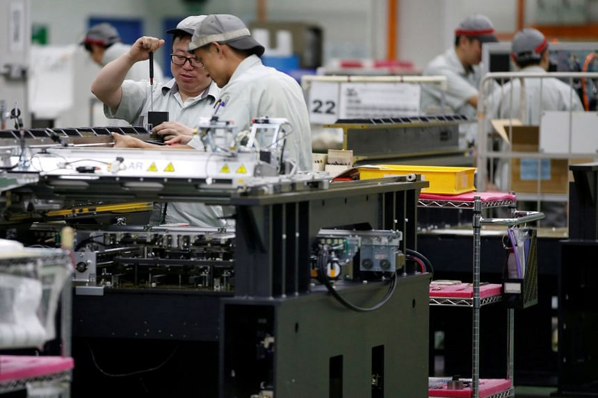 A printed circuit board assembly factory in Singapore. Domestic and export orders shrank last month.