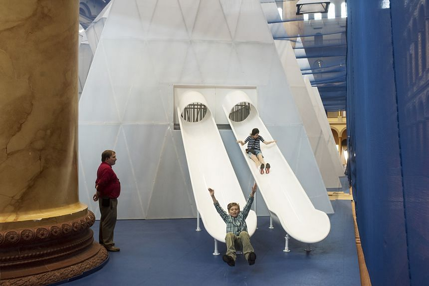 A double slide (left) at the Icebergs exhibition (above), which was inspired by the designers' interest in climate change.