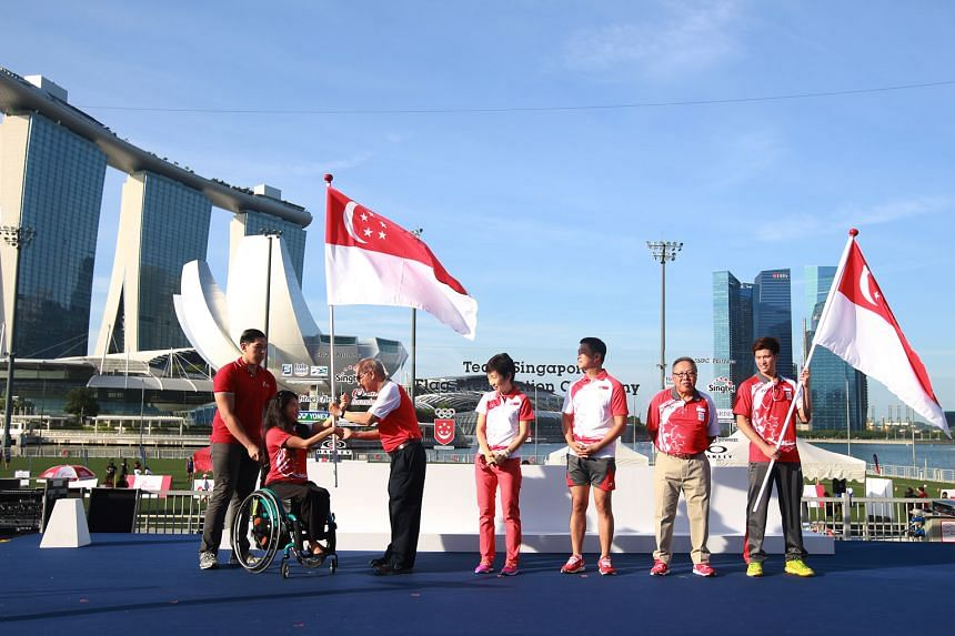 Para-swimmer Yip Pin Xiu (second from left) and shuttler Derek Wong (right), the flag-bearers for the Paralympics and Olympic Games respectively, with their chefs de mission Ho Cheng Kwee and Low Teo Ping. Minister for Culture, Community and Youth Gr