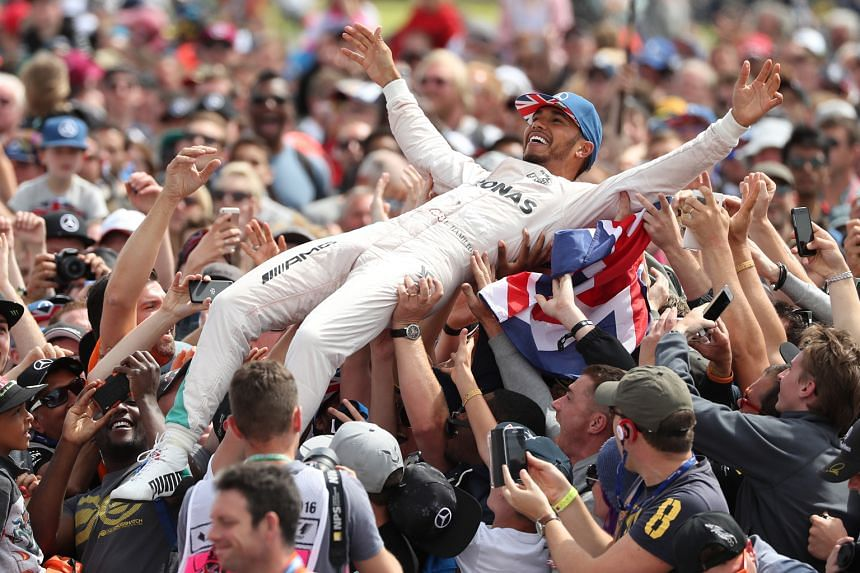 Three-time defending champion Lewis Hamilton enjoying the adulation of the Silverstone support after leading from start to finish to win the British Grand Prix. This was the Briton's third consecutive and fourth overall win at this track, matching fo