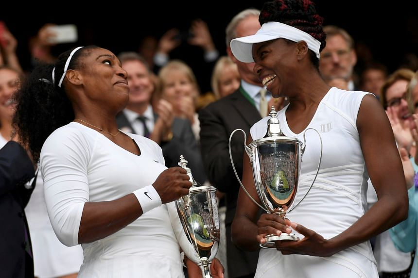 Serena and Venus Williams celebrate winning their doubles final against Hungary's Timea Babos and Kazakhstan's Yaroslava Shvedova. It was Serena's 38th Grand Slam title in total.