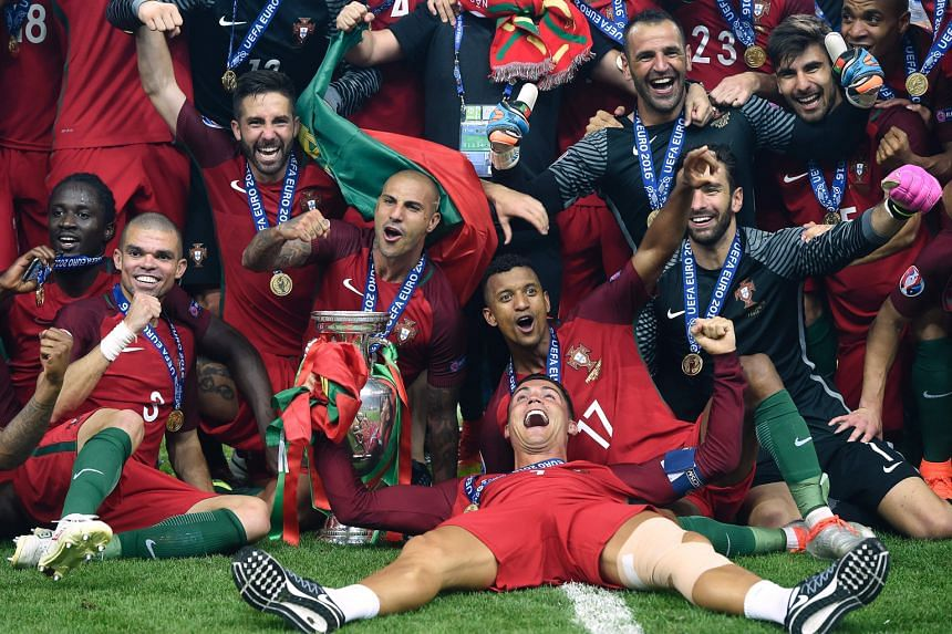 Revelling in the moment of triumph after the 1-0 victory against France, the injured Cristiano Ronaldo (lying down) is flanked by Nani (No. 17), goal-scorer Eder (extreme left), Pepe (second from left) and Ricardo Quaresma (fourth from left).