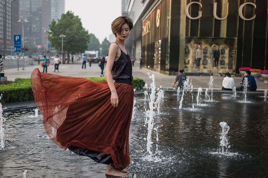 A fashion shoot at a shopping mall in Beijing. China's retail sales growth has been a bright spot for the economy this year.
