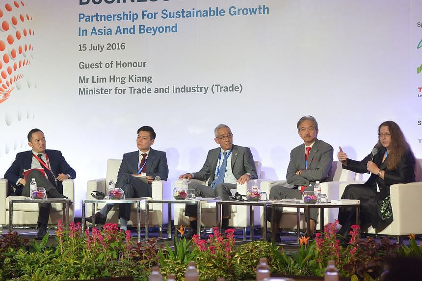 The business forum featured a panel comprising (from left) Mr Ignatius Low, managing editor of SPH's English, Malay and Tamil media division, who was the panel's moderator, IE Singapore chief executive Lee Ark Boon, Japanese Chamber of Commerce and I