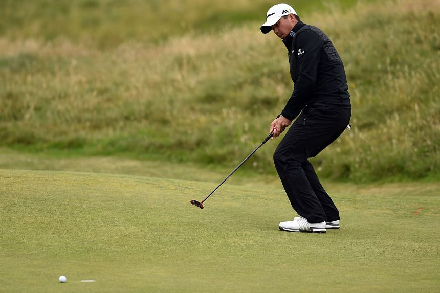 The body language says it all, as Australia's Jason Day shows the anguish of missing his birdie putt on the eighth green during the third round of the British Open at Royal Troon. The world No. 1 had a 71 that left him at one-over 214.