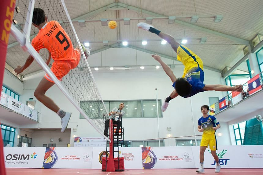 Thailand bagged its 50th Asean University Games gold yesterday, when the men's doubles sepak takraw team of Jutawat Srithong and Korakot Kamolpop (in yellow and blue) defeated Htet Myat Thu and Wai Lin Aung of Myanmar 2-1 in the final, held at the Si