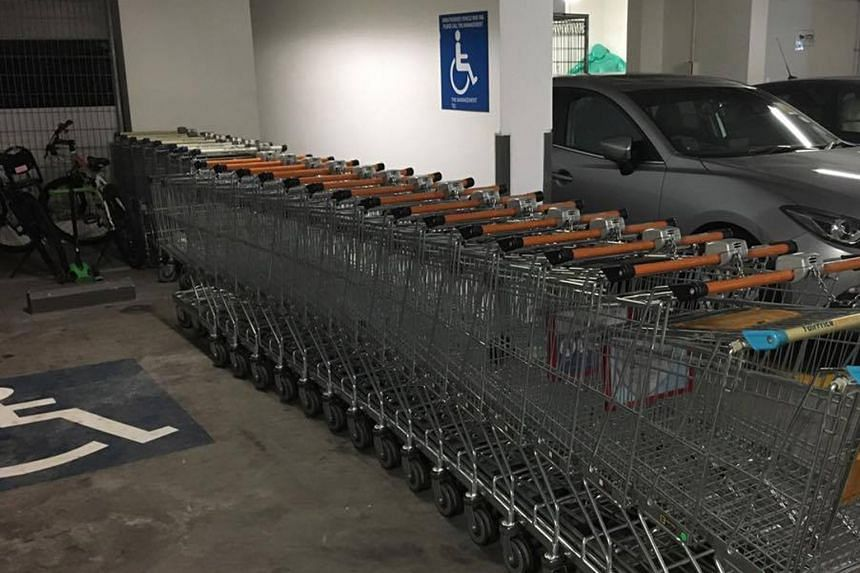The supermarket trolleys had apparently been left in the disabled parking space in the basement carpark of Silversea condominium for more than half a year. They were removed yesterday.