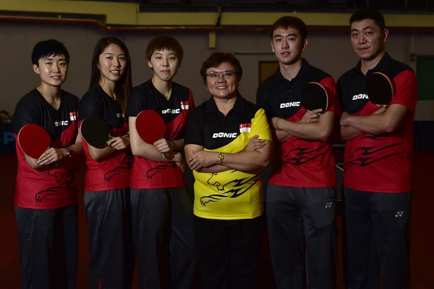 STTA chief Ellen Lee with Olympic players (from left) Feng Tianwei, Yu Mengyu, Zhou Yihan, Chen Feng and Gao Ning. Women's singles second seed Feng, who has a silver and two bronzes at the Games, is favoured to win a medal.
