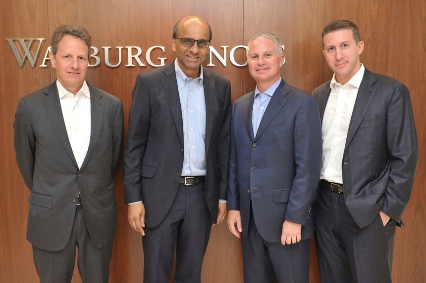 Deputy Prime Minister Tharman Shanmugaratnam, who is also Coordinating Minister for Economic and Social Policies and Monetary Authority of Singapore chairman, with (from left) Warburg Pincus president Timothy Geithner, Mr Kaye and Mr Perlman at the f