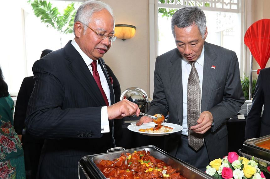 Mr Lee at a lunch hosted by Mr Najib at Seri Perdana in Putrajaya, where a memorandum of understanding on the high-speed rail was inked yesterday.