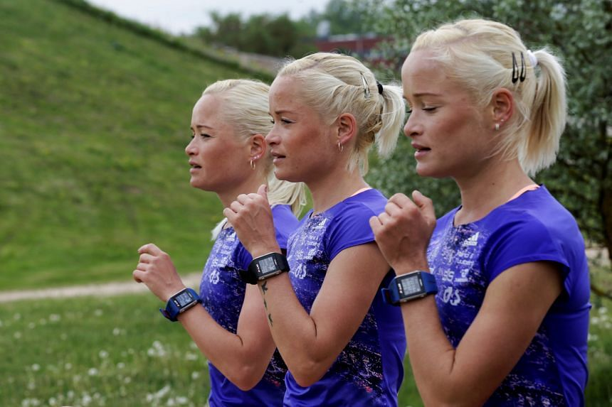 Estonia's female marathon runners for the Olympics (left to right) Lily, Liina and Leila Luik running during a training session in Tartu, Estonia, ahead of the Rio Games next month.