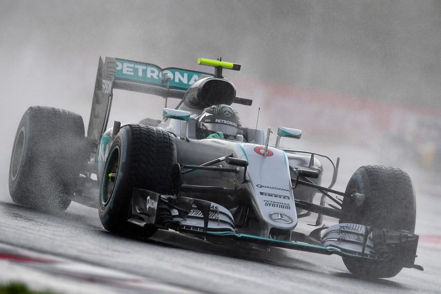 Nico Rosberg negotiating the wet track during yesterday's storm-hit qualifying session for the Hungarian Grand Prix. The German, who leads his Mercedes team-mate Lewis Hamilton by a solitary point in the world drivers' championship, said of his late