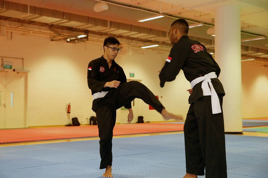 Nur Alfian Juma'en, The Straits Times' Star of the Month, at a silat training session. The 19-year-old won the Asian Pencak Silat Championships last month despite fracturing his hand early in the final.