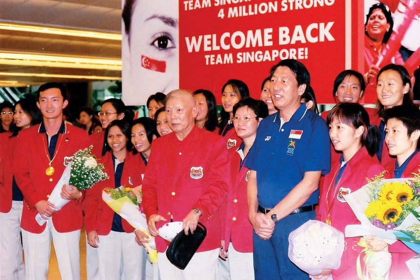 (Above) Dr Tan leading the Singapore contingent to the 2006 Commonwealth Games in Melbourne, despite completing four rounds of chemotherapy just weeks before.