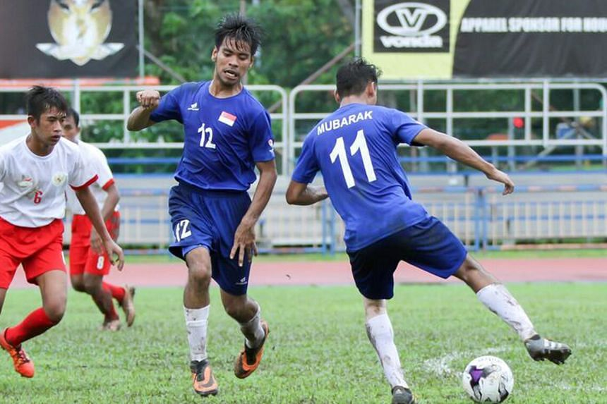 Mubarak Rastam attempting a pass to his Singapore team-mate Shahdil Saidi, as Ammar Hudzaifah of Indonesia closes in during their football friendly on Saturday. The Republic hosted the inaugural Cerebral Palsy Football Invitational from Thursday. The