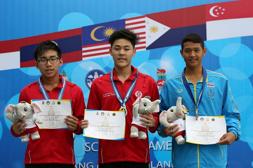 (From left) team-mates Ong Jung Yi (silver) and Maximillian Ang (gold) with Thailand's Phubert Chankeeree (bronze) after the men's 400m individual medley at the 8th Asean Schools Games in Chiang Mai yesterday.