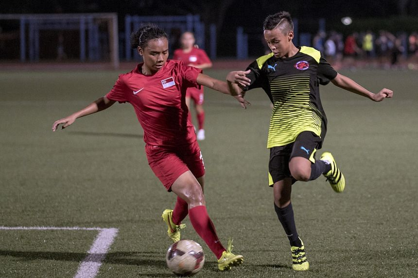 Defender Siti Rosnani Azman (left) during a friendly match last week. The Lionesses are competing in a tournament in Myanmar and will play Vietnam tomorrow.