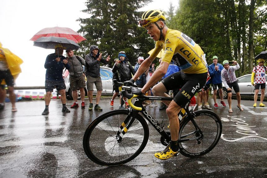 British rider Chris Froome of Team Sky wears the overall leader's yellow jersey during Stage 20 of the Tour de France, a 146.5km section from Megeve to Morzine-Avoriaz, on Saturday.