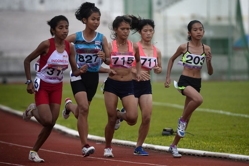 Cambodia's 13-year-old Choronei Ngoun (far right), the youngest runner in yesterday's 3,000m girls' final at the Asean Schools Games in Chiang Mai, Thailand, aims to win a medal at the 2023 SEA Games.