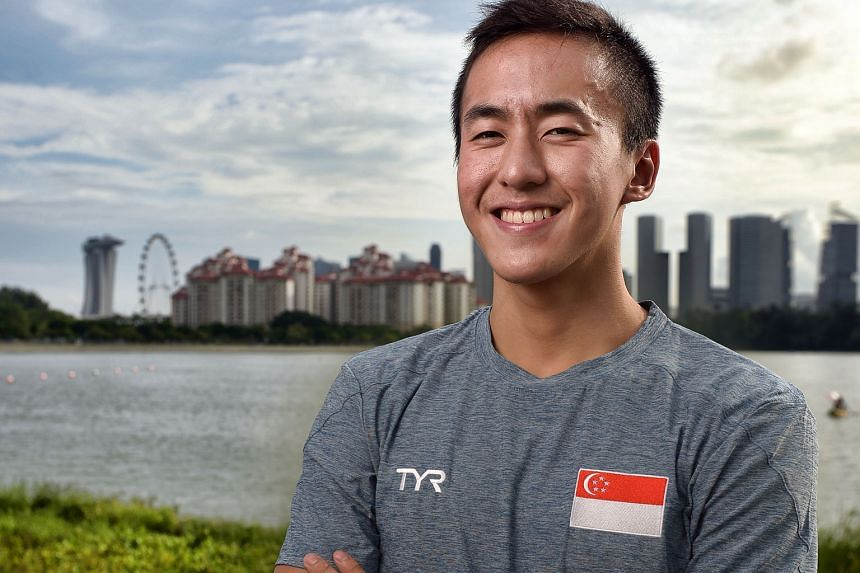 Quah Zheng Wen, 19, near the water's edge in Kallang. Although he is shorter than most elite butterfly swimmers, his exceptional technique allows him to generate power more efficiently than others.