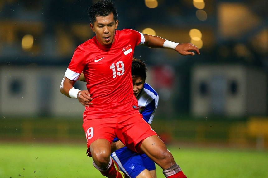 Khairul Amri (left) and Fazrul Nawaz had trouble connecting with the stray high balls pumped forward, as Singapore were beaten 2-1 by Cambodia in Phnom Penh yesterday. But Amri did net the equaliser in the 23rd minute.