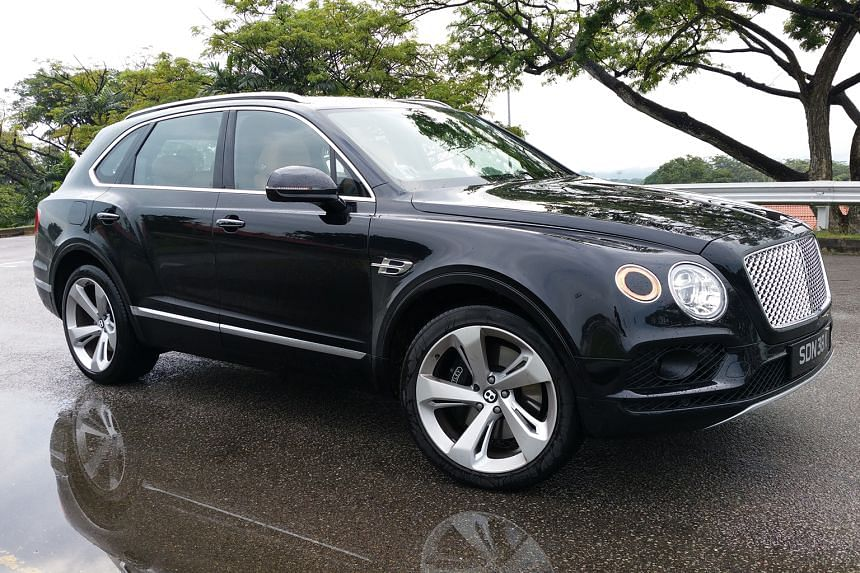 The interior is recognisably Bentley in furnishing and finishing, with all manner of gadgetry and plenty of room for both passengers and luggage.