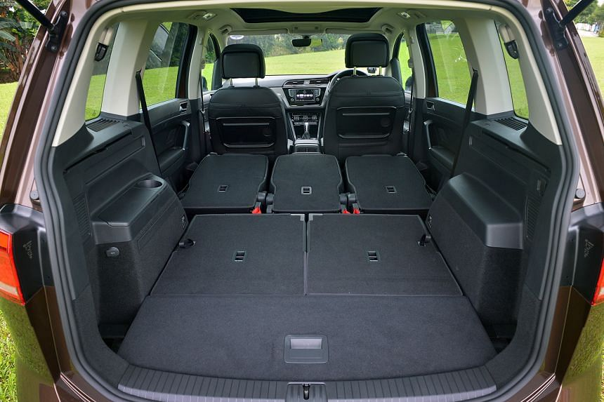 The new Volkswagen Touran's fold-flat seats now extend to the second row, freeing up a huge stowage area.